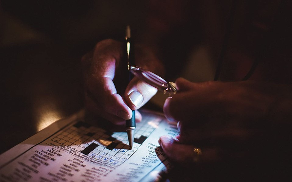 Person uses Mighty Bright Lighted magnifying