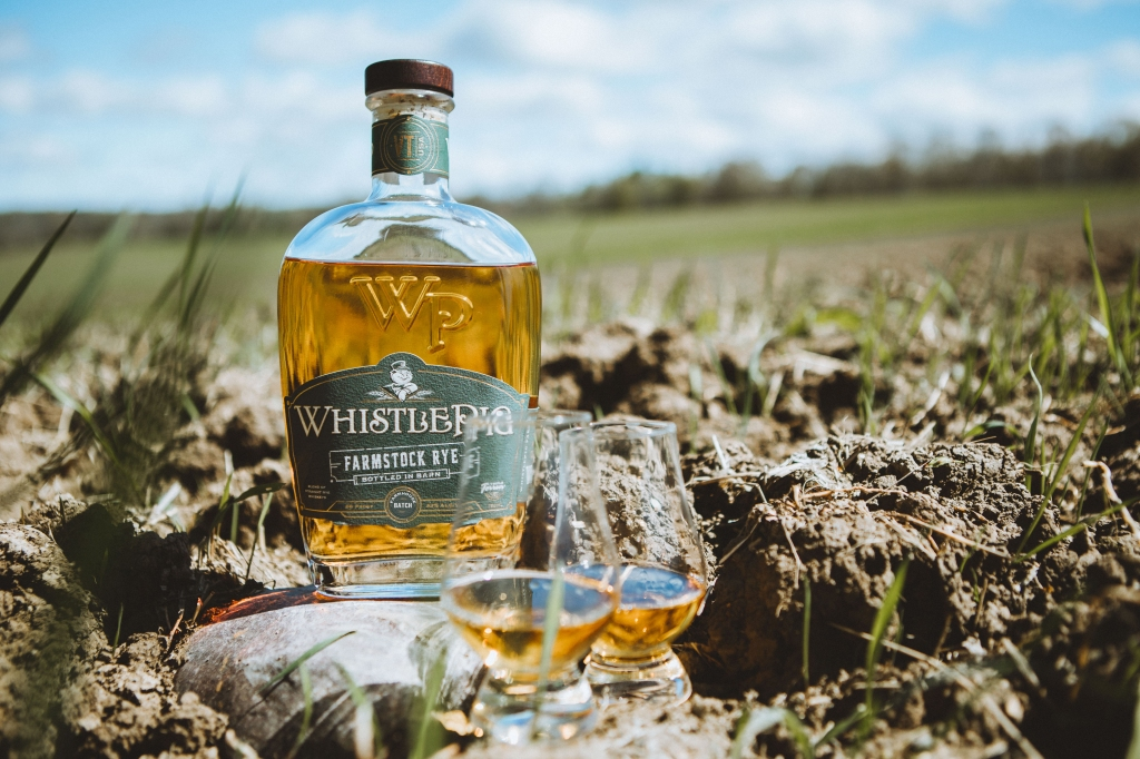 WhistlePig lifestyle shot in field