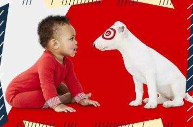 baby looking at Target dog