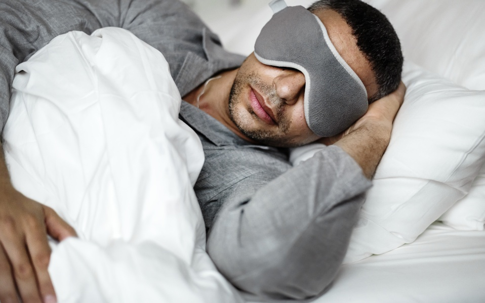 A man sleeping on a bed