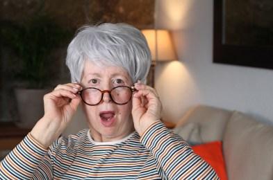 Shocked senior woman with eyeglasses
